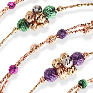 золоті браслети прикрашені намистинами
