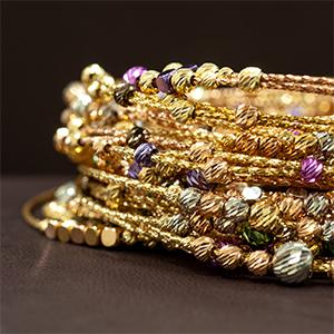 золоті браслети колекції Orbit